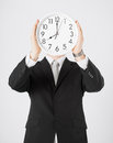 Man with wall clock covering his face Royalty Free Stock Photo