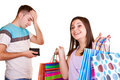 Man with wallet and girl with bags Royalty Free Stock Image