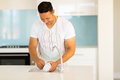 Man washing dishes in the kitchen Royalty Free Stock Photo