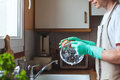 Man washing dishes in the kitchen sink at home Royalty Free Stock Photo
