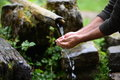 Man washing hands in fresh, cold, potable water Royalty Free Stock Photo