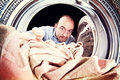 Man and washing machine Royalty Free Stock Photo