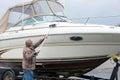 Man washing power boat
