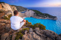 Man watching sunset over Navagio beach on Zakynthos Royalty Free Stock Photo