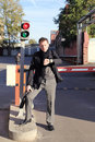 Man watching time by traffic light Royalty Free Stock Photo