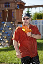 Man in a water gun fight Royalty Free Stock Images