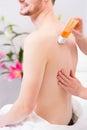 Man at waxing hair removal in beauty parlor Royalty Free Stock Photo