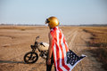 Man wearing american flag cape and golden helmet Royalty Free Stock Photo