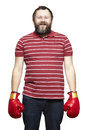 Man wearing boxing gloves smiling white background Royalty Free Stock Image