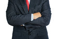 Man wearing business suit and black tie with arms crossed isolat Royalty Free Stock Photo