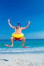 Man wearing flippers and rubber ring at the beach Royalty Free Stock Photo