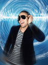 Man wearing headphones and sunglasses cool young in front of blue circular effect Stock Photos