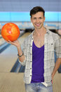 Man wearing in shirt holds ball in bowling club Royalty Free Stock Photography