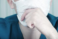 Man wearing a surgical mask thinking photo Stock Photo