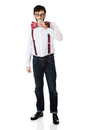Man wearing suspenders drinking milk. Royalty Free Stock Photo