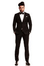 Man wearing tuxedo standing with hands in pockets fashion full body picture on white background Stock Photography