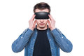 Man wearing virtual reality goggles isolated on white background young Stock Images