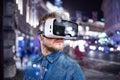 Man wearing virtual reality goggles. Night city. Royalty Free Stock Photo