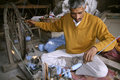 Man weaving at workshop, delhi Royalty Free Stock Photo