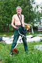 Man with weed trimmer Stock Photo