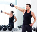 Man with weight training equipment on sport gym Stock Photos