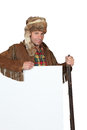 Man in an western costume with raccoon skin hat and blank board ready for text or image Stock Images