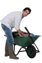 Man with a wheelbarrow Stock Photography