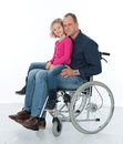 Man in wheelchair with daughter wife and Stock Photos