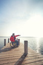 Man in wheelchair enjoying beach spring vacation outdoors Royalty Free Stock Photography