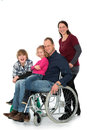 Man in wheelchair with family wife and children Royalty Free Stock Image
