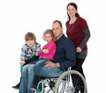 Man in wheelchair with family wife and children Stock Image