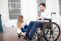 Man in wheelchair getting some help Royalty Free Stock Photo