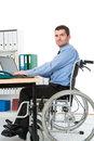 Man in wheelchair in the office on his workplace Royalty Free Stock Photo