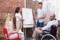 Man in wheelchair smiling at camera during presentation Royalty Free Stock Photo