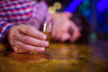 Man with whiskey glass lying on bar counter Royalty Free Stock Photo