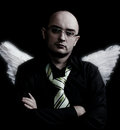 Man with white angel wings looking forward Royalty Free Stock Photo