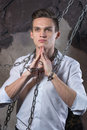 The man in the white shirt and bound in chains. Royalty Free Stock Photo