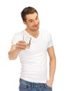 Man in white shirt with glass of water Stock Photography