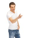 Man in white shirt pointing his finger Stock Photos