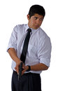 Man in white shirt and tie with a gun Stock Image