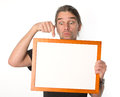 Man with white signboard is showing on a Royalty Free Stock Image