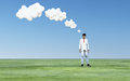 Man with white thought clouds Stock Image