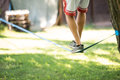 Man who came up on Slackline Royalty Free Stock Photo