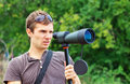 Man who is watching in spotting scope positive looking through a telescope Stock Photo