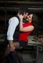 Man and wife in loving pose a men mafia role play or sensual Stock Photos