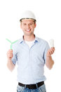 Man with a wind turbine and a light bulb. Royalty Free Stock Photo