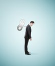 Man with winder businessman stands without energy the back Stock Photo