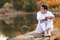 Man wine alone thoughtful young drinking by a lake Royalty Free Stock Photography