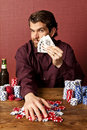 Man winning at poker Stock Photos