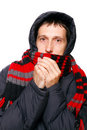 Man in winter clothes shivering from the cold Royalty Free Stock Image
